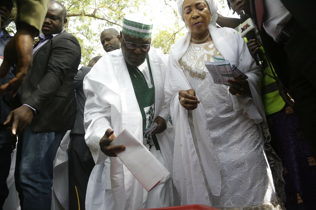 Leading opposition presidential candidate Atiku Abubakar casts his vote during the Presidential and National Assembly election in Yola Nigeria, Saturday, Feb. 23, 2019. Africa's most populous country goes to the polls on Saturday to decide whether President Muhammadu Buhari deserves a second term. While more than 70 people are running to lead Nigeria, the close race comes down to Buhari and a billionaire former vice president, Atiku Abubakar. (AP Photo/Sunday Alamba)