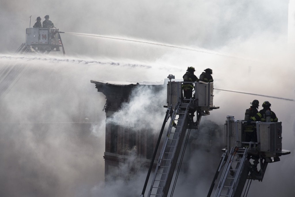 Firefighters spray water on a collapsed building in New York's East Village. AP Photo/John Minchillo