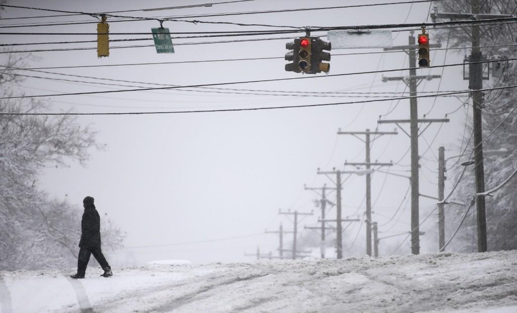 A man walks across an empty street in Nashville, Tenn. AP Photo/Mark Humphrey