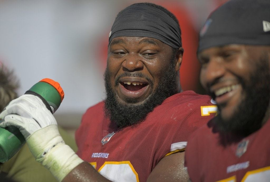Washington Redskins offensive guard Jonathan Cooper, left shares a laugh with Washington Redskins offensive tackle Ty Nsekhe on the bench. (John McDonnell/The Washington Post)
