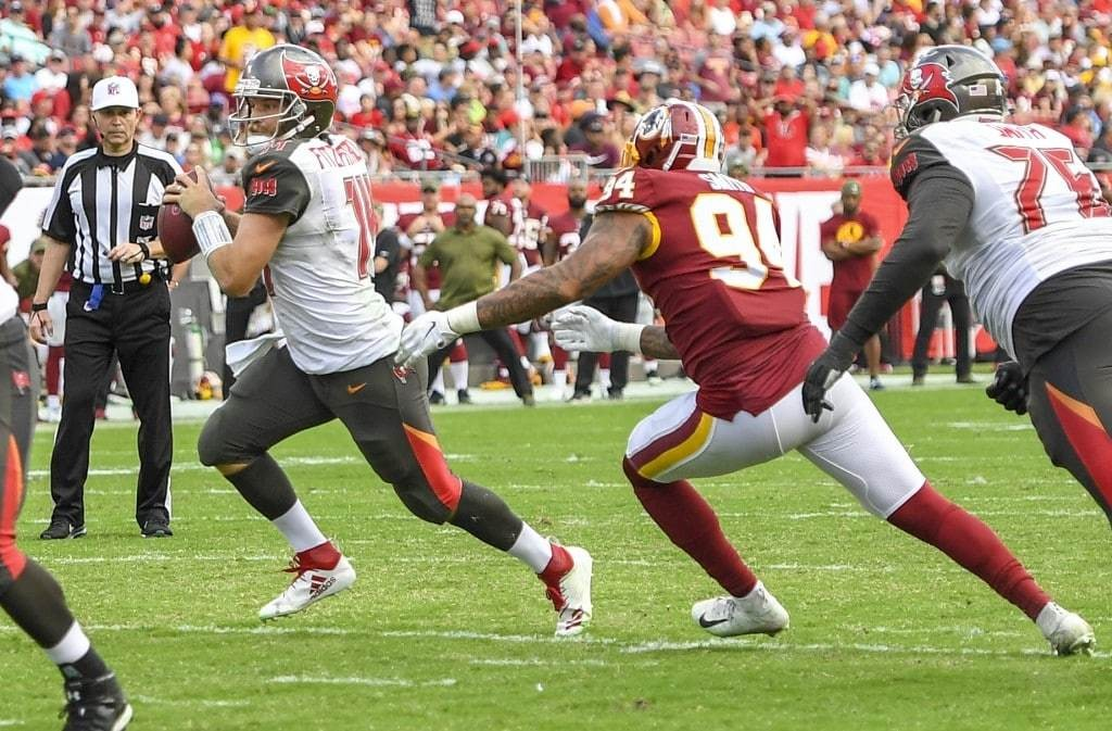 Redskins outside linebacker Preston Smith chases down Tampa Bay Buccaneers quarterback Ryan Fitzpatrick for a fourth quarter sack and fumble that was recovered by Washington. (Jonathan Newton/The Washington Post)
