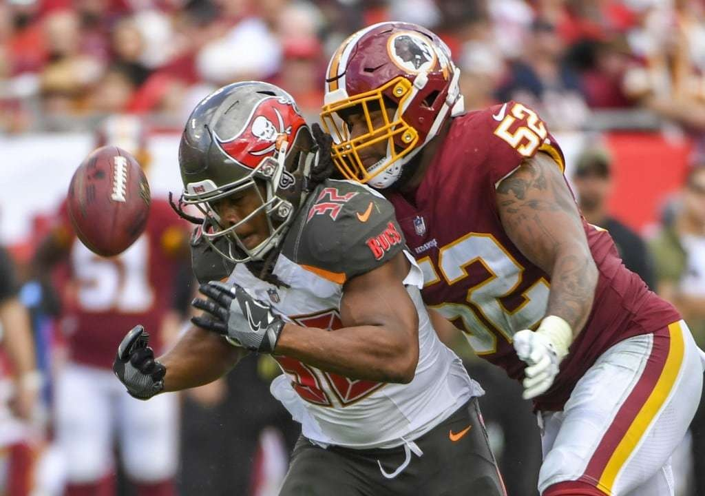 Washington Redskins linebacker Ryan Anderson punches the ball out of the hands of Tampa Bay Buccaneers running back Jacquizz Rodgers. (Jonathan Newton/The Washington Post)