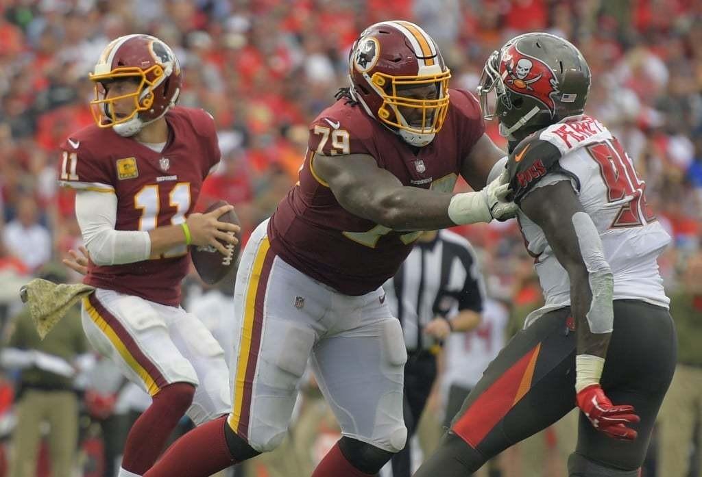 Washington Redskins quarterback Alex Smith, left, drops back as Washington Redskins offensive tackle Ty Nsekhe, center, blocks Tampa Bay Buccaneers defensive end Jason Pierre-Paul. (John McDonnell/The Washington Post)