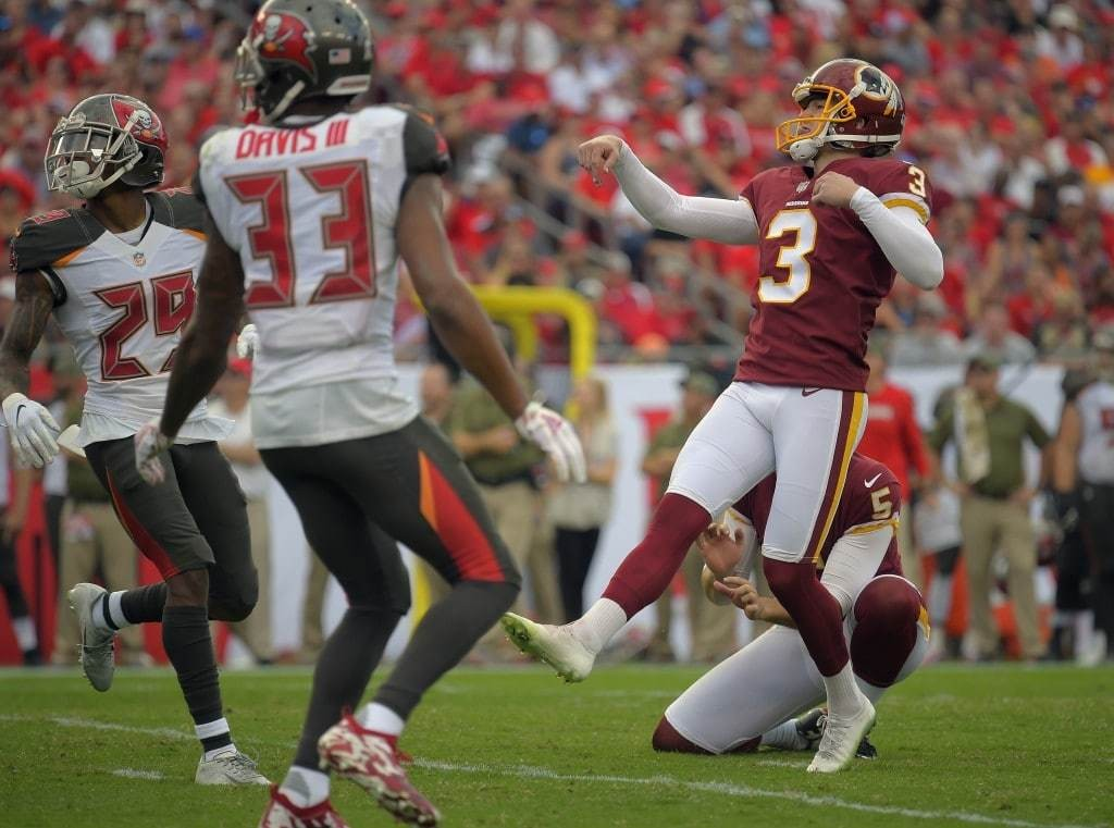 Redskins kicker Dustin Hopkins watches his third field goal go through the uprights.. (John McDonnell/The Washington Post)