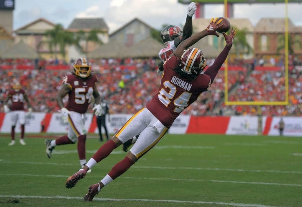 Washington Redskins cornerback Josh Norman gets a 1st quarter goal line interception against Tampa Bay. (John McDonnell/The Washington Post)