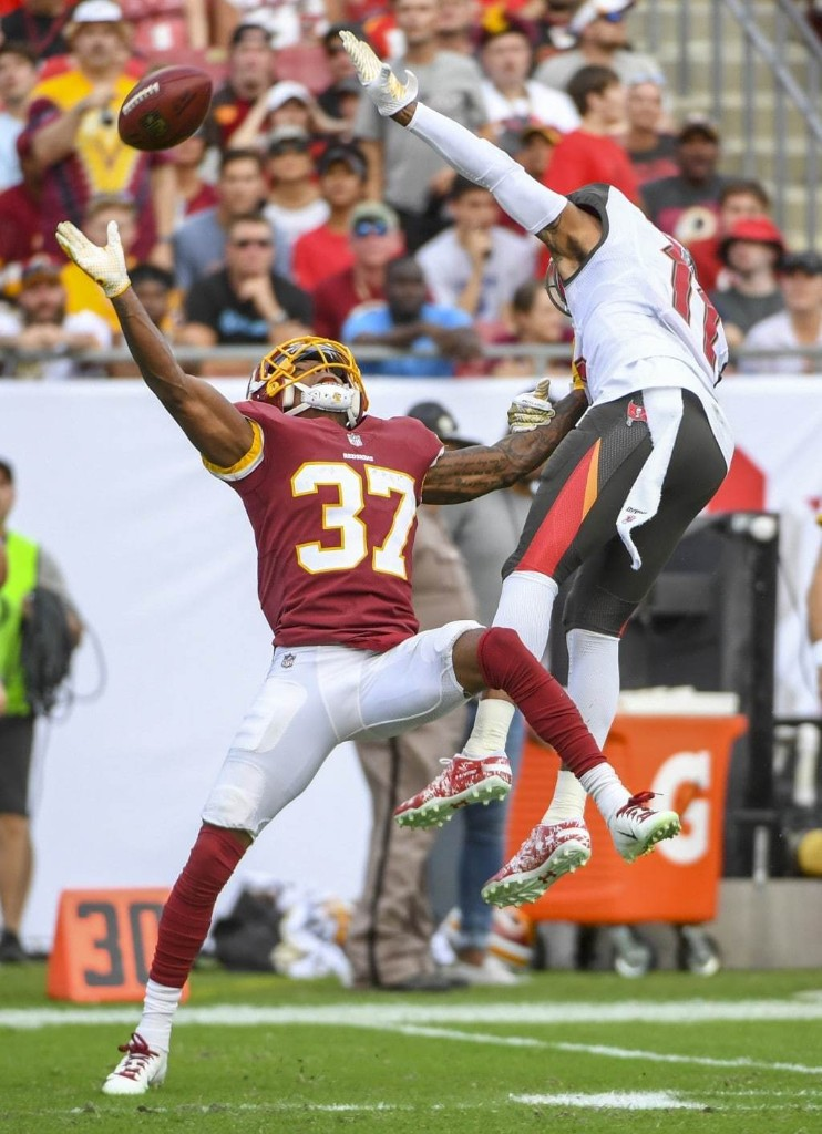 Washington Redskins cornerback Greg Stroman knocks away a pass intended for Tampa Bay Buccaneers wide receiver DeSean Jackson. (Jonathan Newton/The Washington Post)
