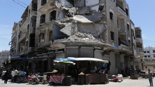 Syrian forces pound rebel targets in the besieged northwest