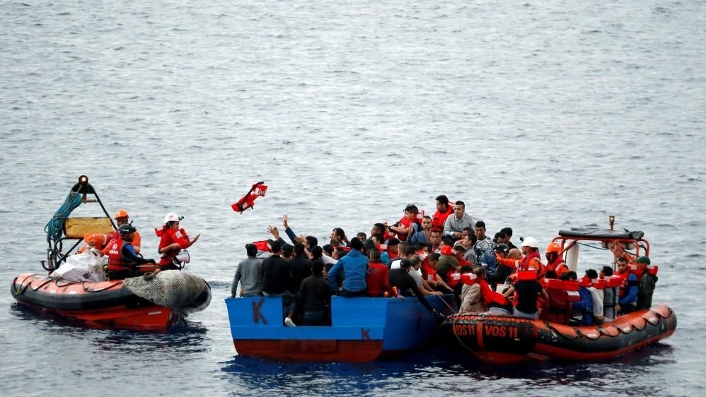 Refugees + Migrants - Magazine cover
