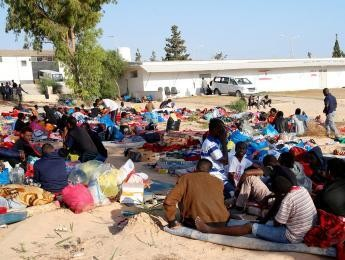 Why are migrants being killed in Libya?