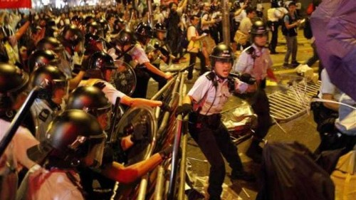 Hong Kong protesters battle police