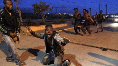 African migrants climb their way into Spain