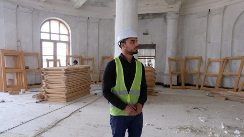 Opinion divided as war-scarred Kabul palace restored