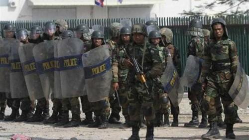 Cambodian troops in riot gear break up strike