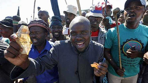 S African striking miners reject wage offer