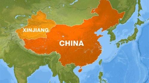 China sentences 12 to death in Xinjiang