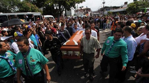 Venezuelans protest after teenager is killed by police