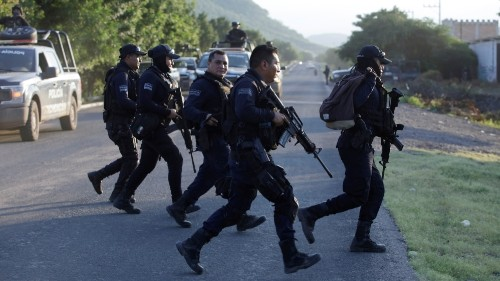 Mexico's Obrador faces anger after police killed in cartel ambush