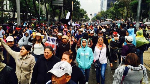 Thousands march in Mexico over students