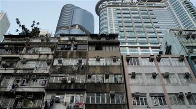For Hong Kong leader, home building alone may not resolve crisis