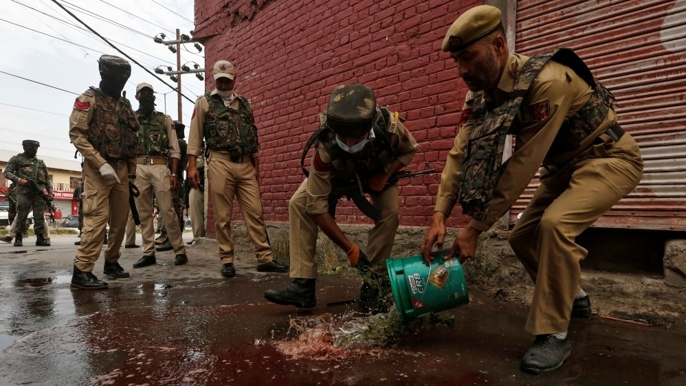 Rebels kill police in Kashmir ahead of India's Independence Day