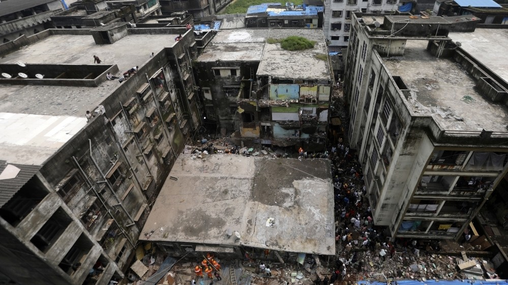 India building collapse toll climbs to 20, several still trapped