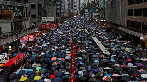 Hundreds of thousands march in latest Hong Kong protest