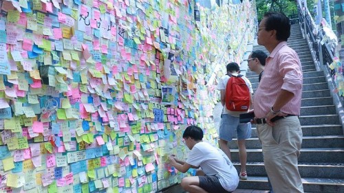When walls talk: Hong Kong protesters bring grievances to suburbs