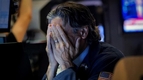 Wall St stocks fall as US-China dispute turns into 'currency war'