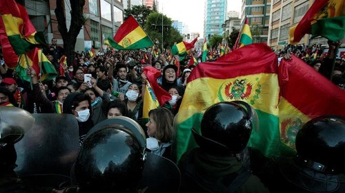 Bolivia's Morales says 'coup in progress' as rivals dispute vote