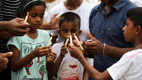 Sri Lanka revises bombings death toll down by 100