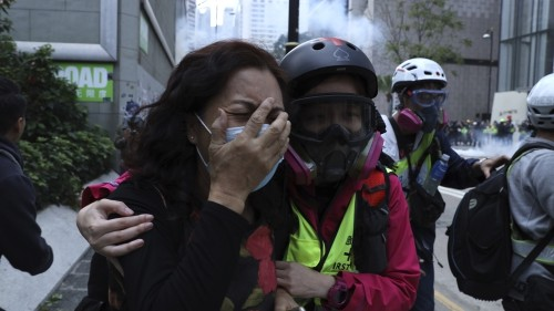 Clashes cut short Hong Kong rally as police officers are attacked