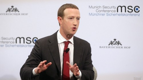Facebook boss backs tighter rules on 'harmful online content'