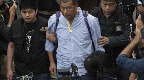 Hong Kong media tycoon resigns after arrest