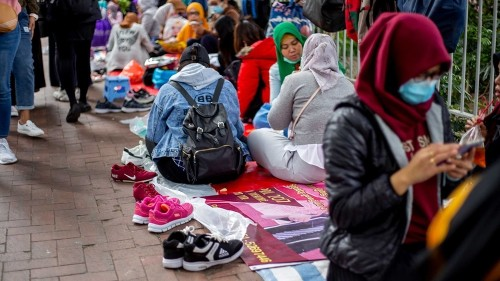 Hong Kong domestic workers fight for day off amid infection fears