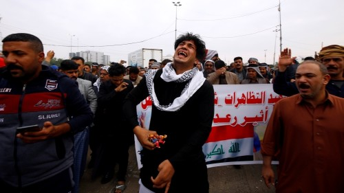 Iraqi families mourn their dead after protests' 'bloodiest day'