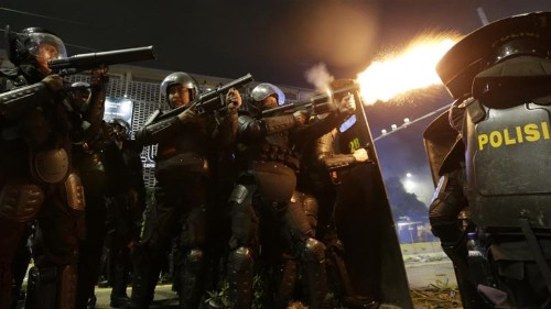 Jakarta clashes rage in second night of unrest over poll result