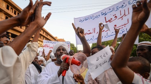 Sudan's military says talks to resume as barricades removed