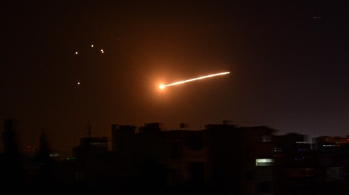 Syria air defences down Israeli missiles over Homs: state media