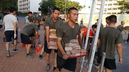China's PLA soldiers on Hong Kong streets in 'voluntary' clean-up