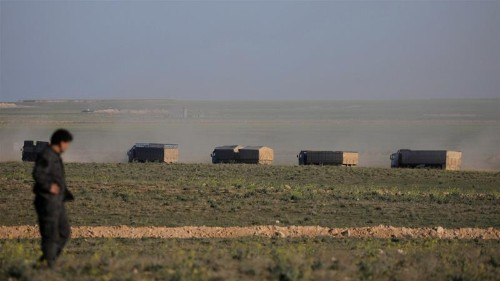 Syria's war: Trucks carrying women, children leave ISIL enclave