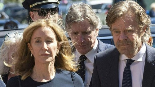 Felicity Huffman gets 14 days behind bars in US college scandal