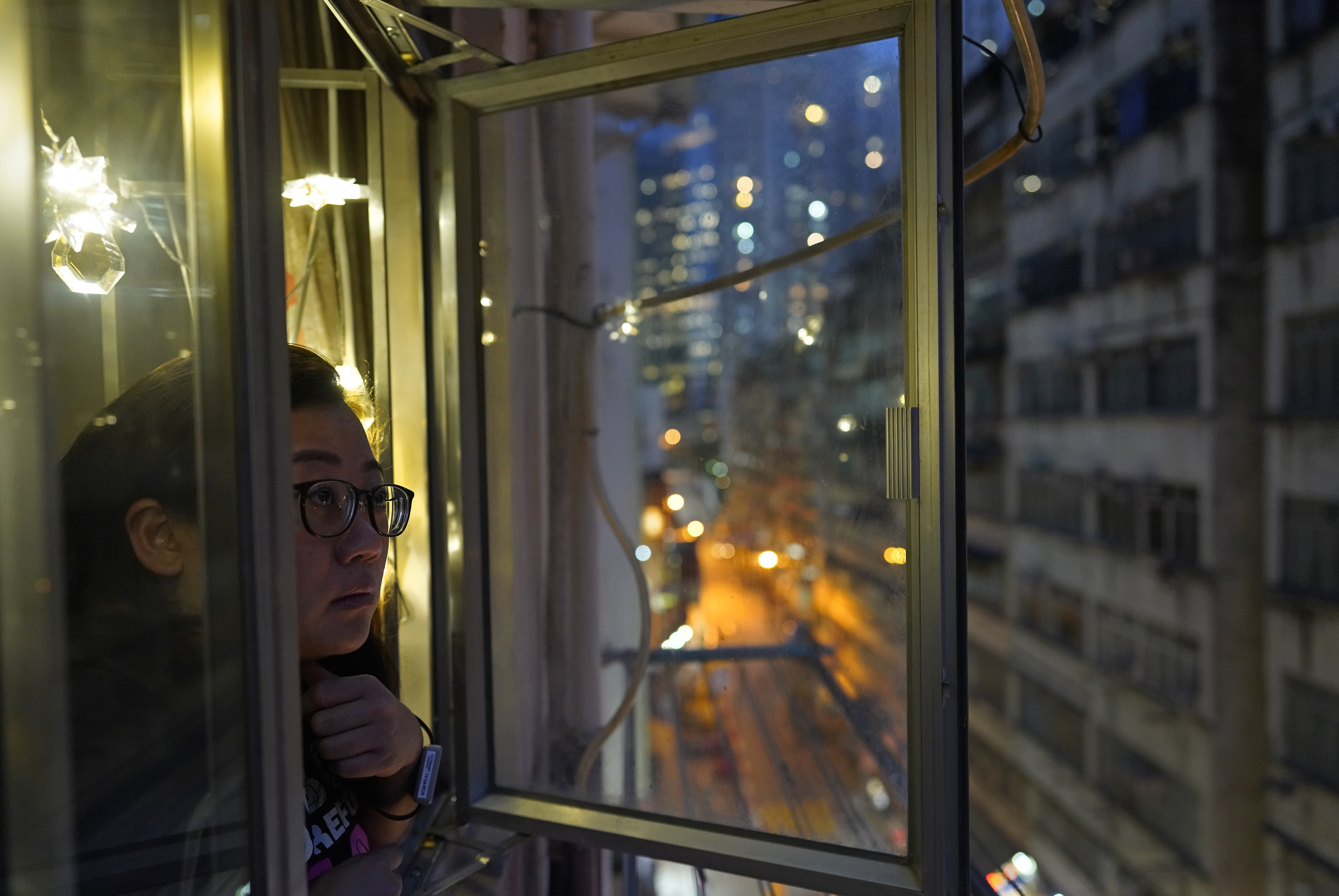 VIRUS DIARY: In Hong Kong lockdown, watched by a wristband