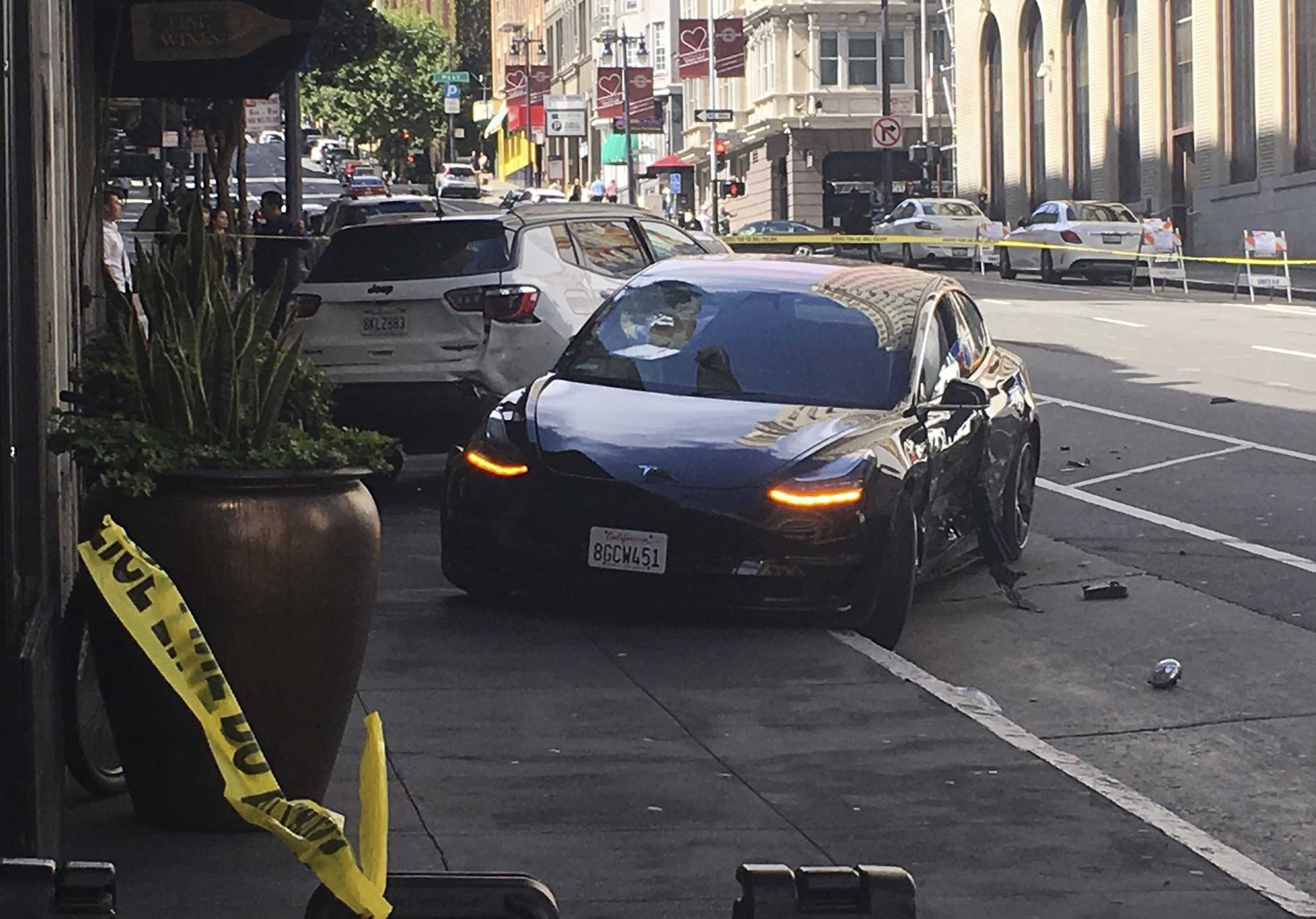 Police investigate if crashed car was partially self-driving