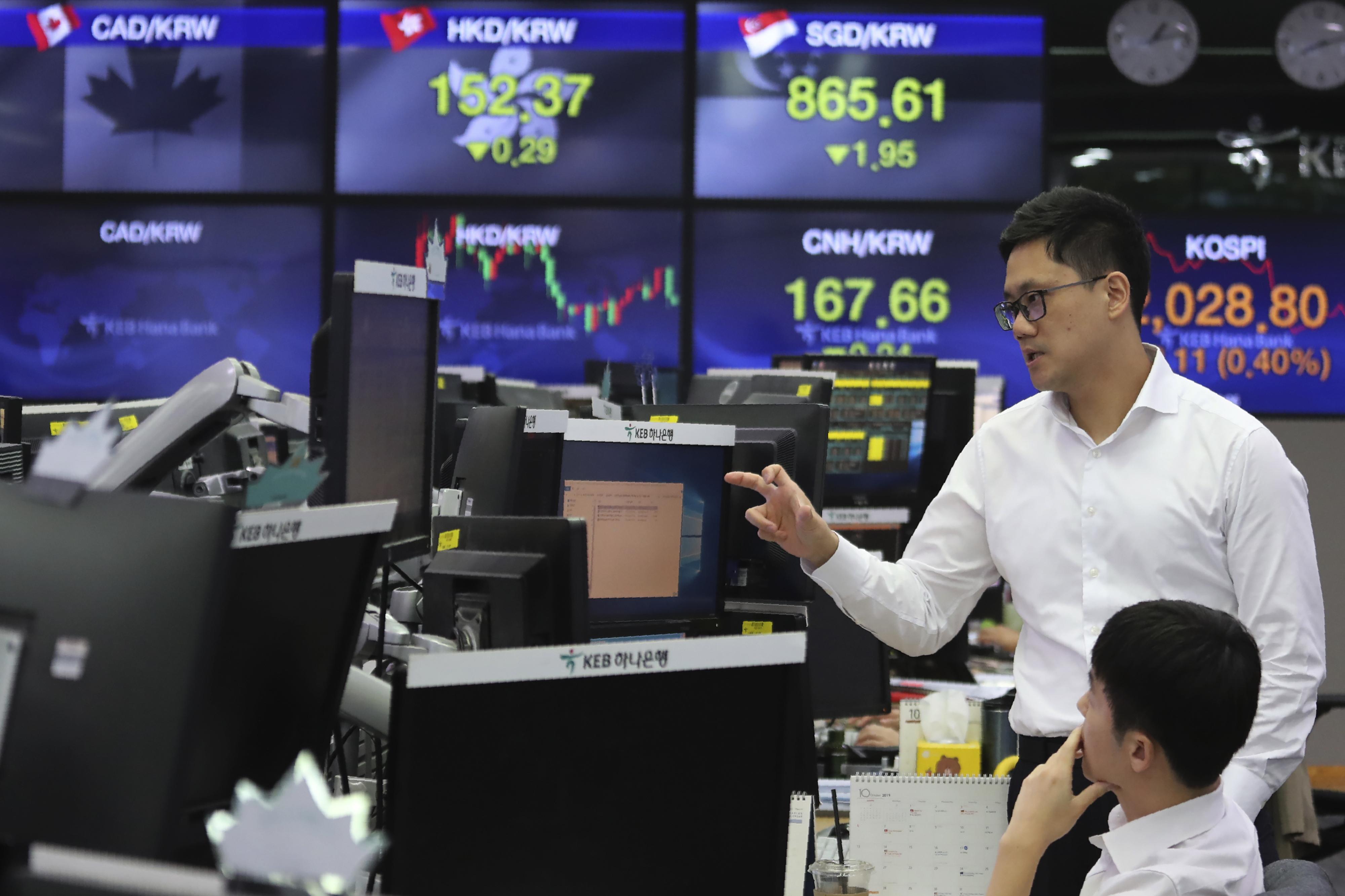 Asian shares mixed on US jobs, eyes on China trade talks