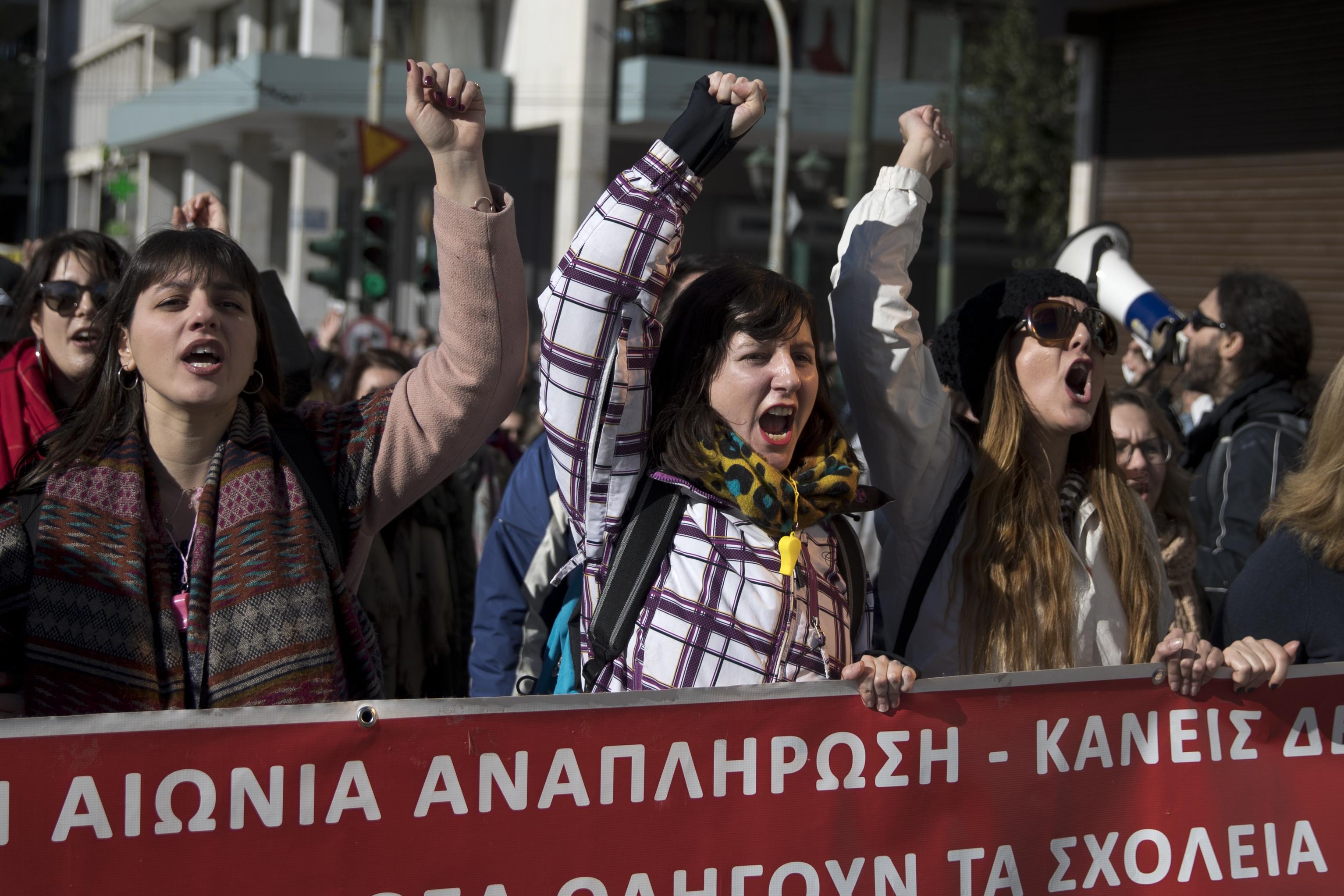 Striking Greek school teachers shut down traffic in Athens