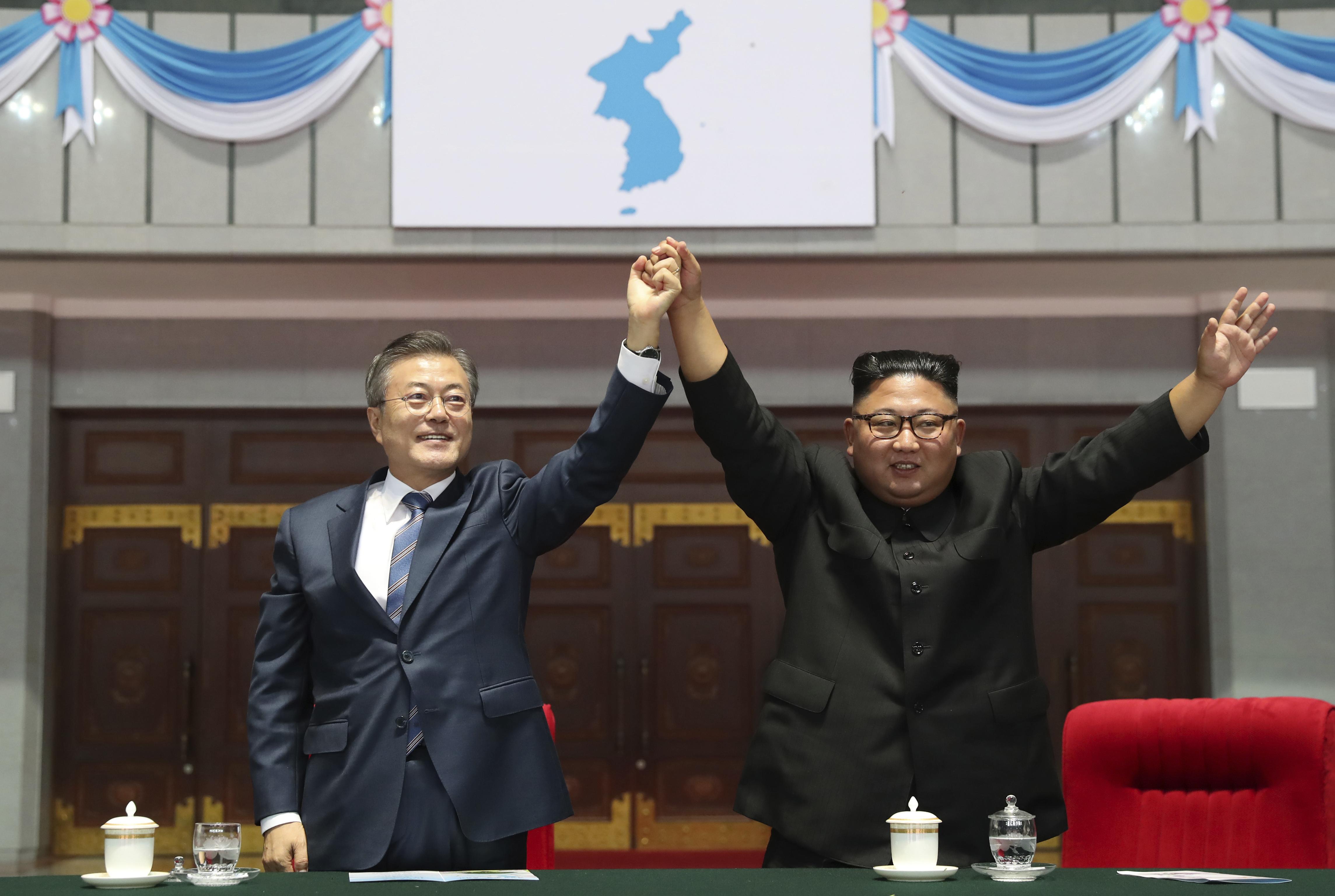 Kim, Moon head to North Korea's sacred volcano on final day