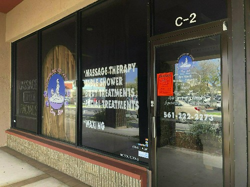 Customers videotaped at spa in Kraft case sue authorities