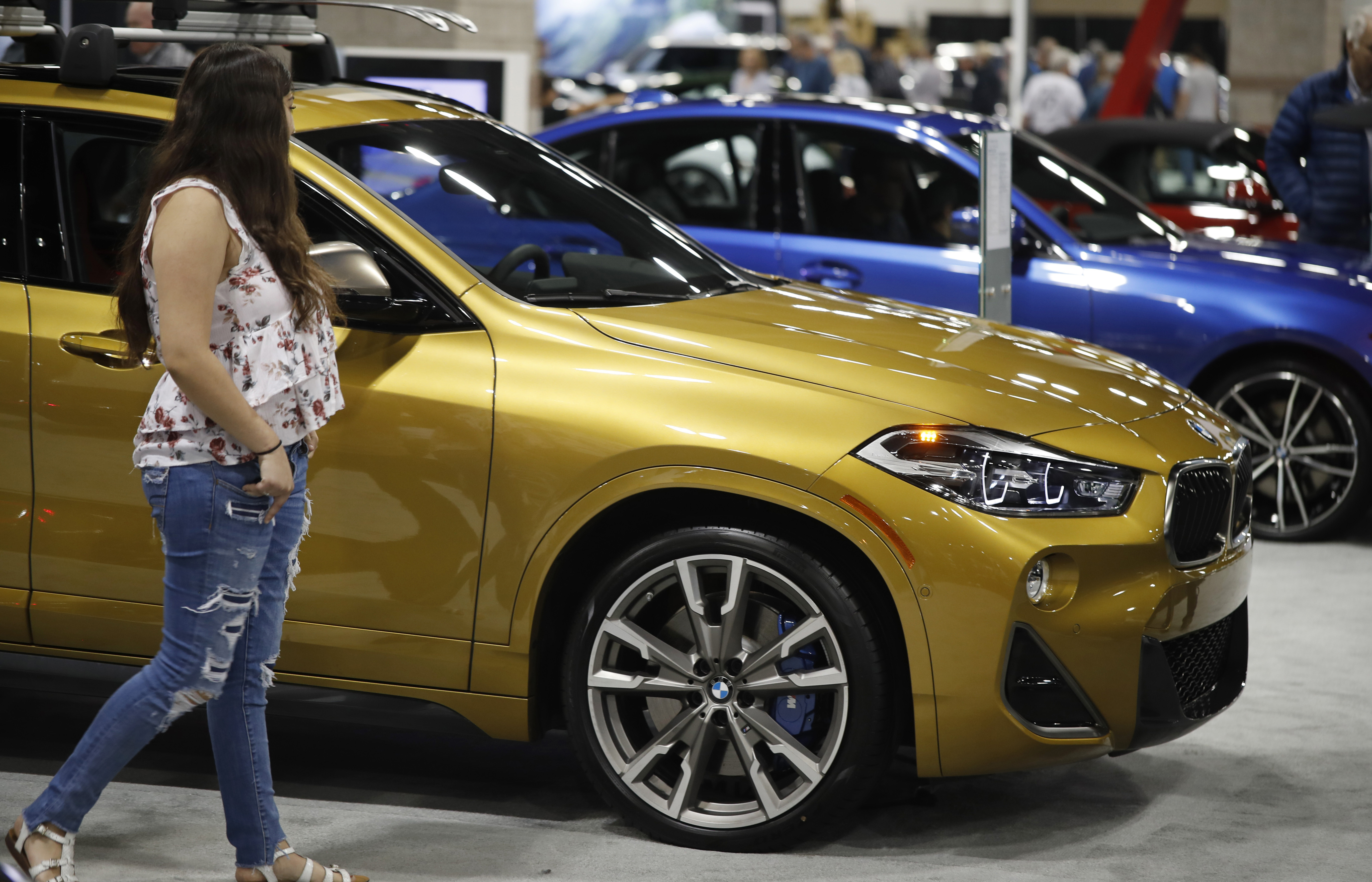 Used luxury or fully-loaded new car? Edmunds weighs both