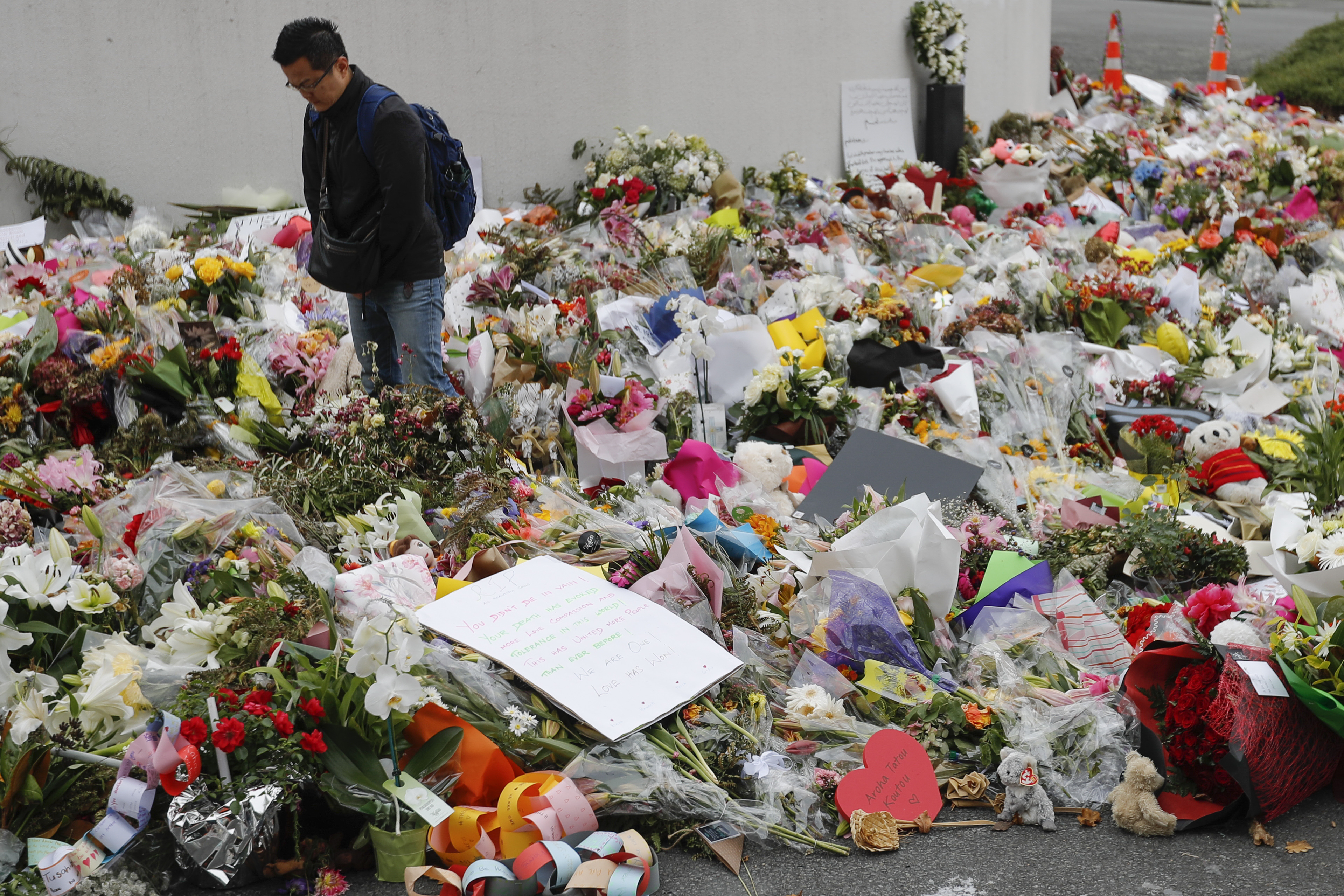 The Latest: New Zealand bans all assault weapons immediately