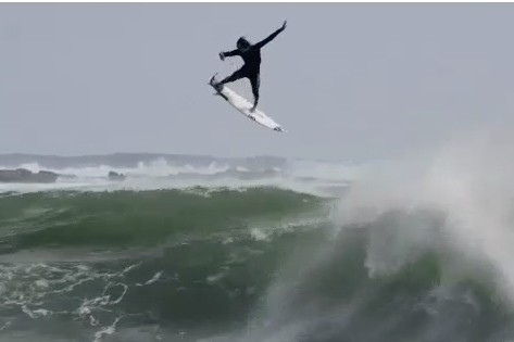 Surfer Jordy Smith Goes Airborne for Incredible 360 While Riding Wave
